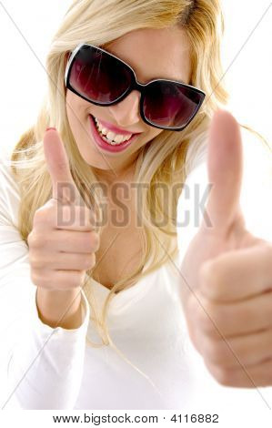 High Angle View Of Glad Female Model With Thumbs Up
