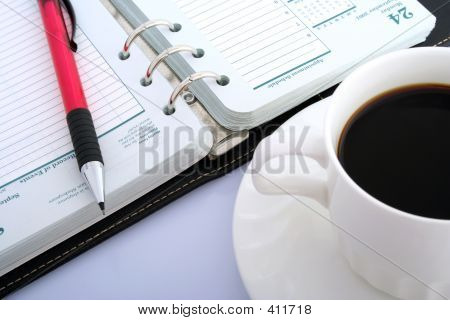 Pencil, Notebook And Black Coffee