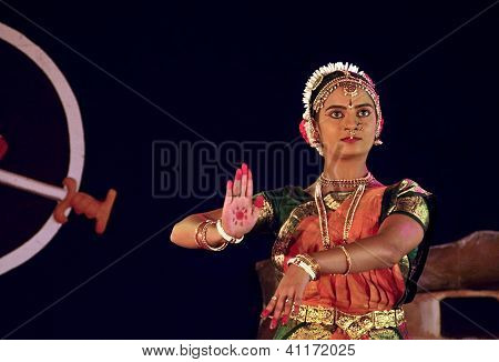 A young Bharatnatyam dancer performing