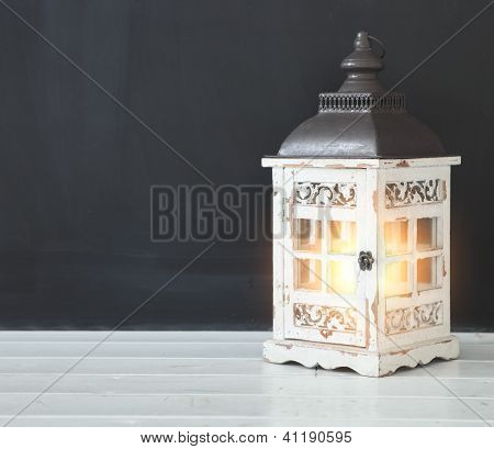 Old Retro Lamp Near The Empty Blank Black Chalkboard
