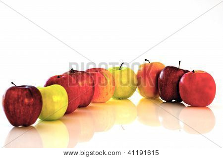 Nine Apples In Assorted Colors In A Curve
