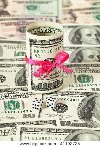 Us Dollars Wrapped By Ribbon On Money Background