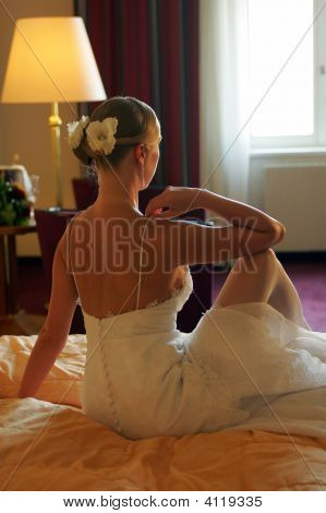 Bride Sat On Bed Rear View