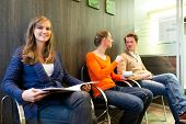 stock photo of trustworthiness  - Female patient at reception of clinic looking at the viewer - JPG