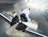 image of propeller plane  - Dramatic scene on the sky - JPG