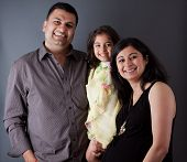 stock photo of east-indian  - Image of an East Indian family with the father mother and their daughter - JPG