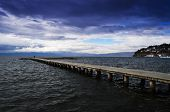 Stone pier and stormy weather