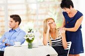 stock photo of mother law  - caring mother standing by her daughter when she has marriage problem - JPG