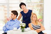 image of mother law  - middle aged mother feeling helpless when caught in between young couple - JPG