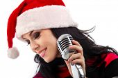 Christmas Singer standing in front of a microphone. Isolated on a white background (focus on microph