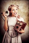 stock photo of prank  - Shocked Young Woman Holding Old Wooden Box Phone While Working As A Telephone Operator In A Good News Or Bad News Concept - JPG