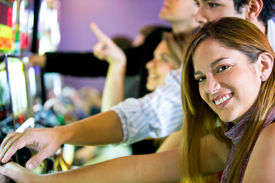picture of slot-machine  - couple playing at the slot machines in a casino - JPG