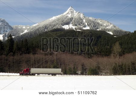 Truck Transports Goods Over Road Through North Cascades Washington State