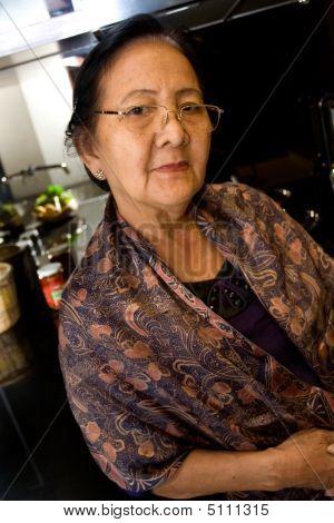 Elderly Woman In The Kitchen