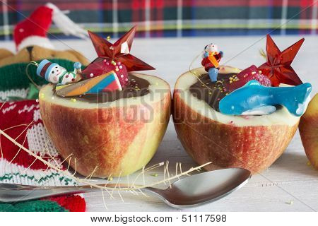Apples Stuffed With Chocolate. Dice Fruit, Impregnating In You Red Fruit And Toys