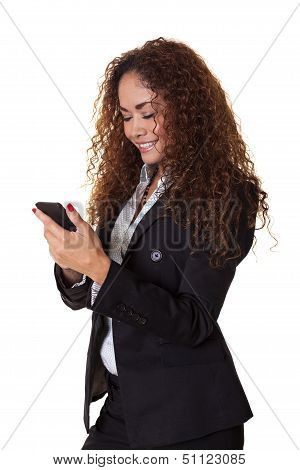 Beautiful Woman Smiles With Her Cell Phone.