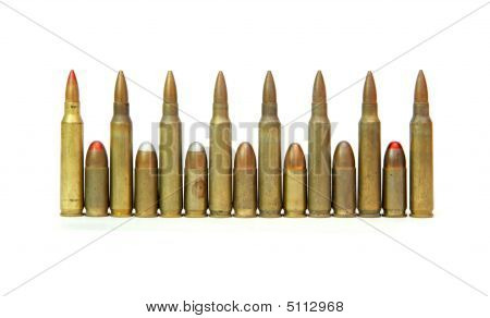 Row Of Rifle And Pistol Cartridges Isolated