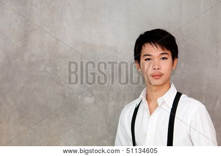 A Teenager Boy With White Shirt And Suspenders