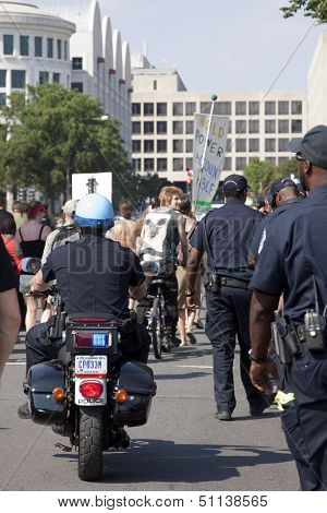 WASHINGTON - SEPT 11: Capitol Police on foot and motorcycles escort a mix of activists, many of whom are 9/11
