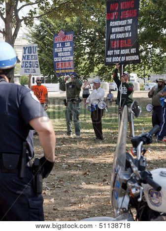 WASHINGTON-SEPT 11: Men opposed to the 9/11 Truthers stand behind police on September 11, 2013 in Washington, DC. Christian groups and the 2 Million Bikers group objected to the Million Muslim March.