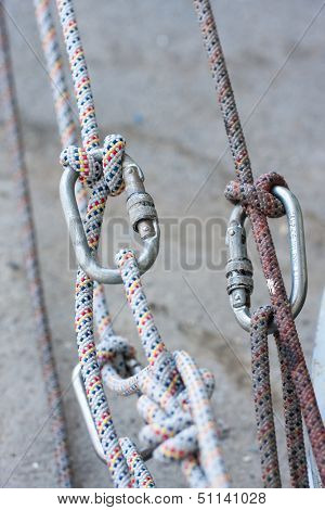 Climbing equipment - knot, rope, carabiner.