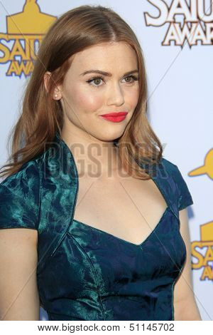 LOS ANGELES - JUN 26:  Holland Roden arrives at the 39th Annual Saturn Awards at the Castaways on June 26, 2013 in Burbank, CA