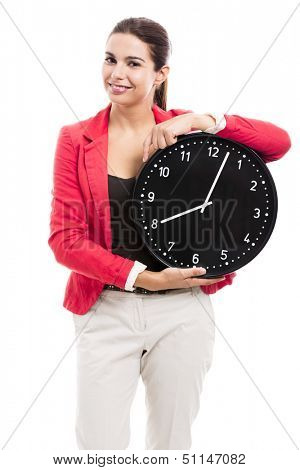 Business woman holding a big clock on the hands