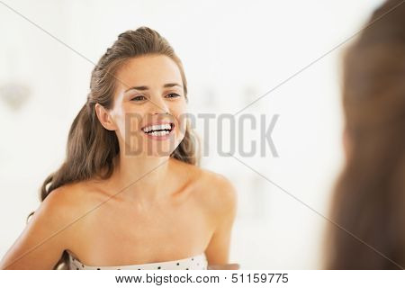 Woman Checking Tooth In Bathroom