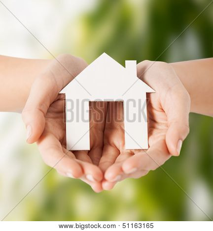 eco, bio, home, nature, power saving concept - woman hands holding house