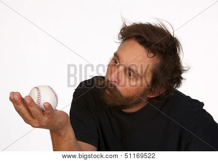 Crazed Baseball fan studying a Foul Ball on White Background