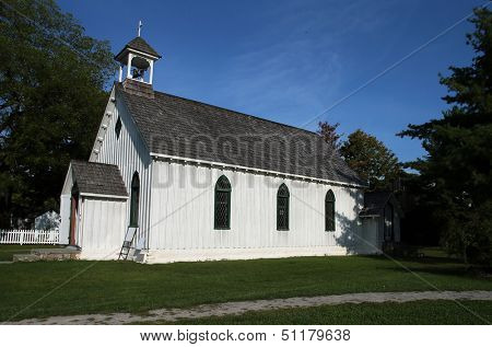 Historic Little White Church with cross and bell tower