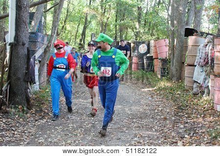 MUSKOGEE, OK - Sept. 14: Athletes dressed as Mario Brothers avoid zombies during the Castle Zombie Run at the Castle of Muskogee in Muskogee, OK on September 14, 2013.