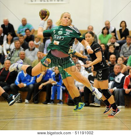 SIOFOK, HUNGARY - SEPTEMBER 14: Heidi Loke (green 5) in action at a Hungarian Championship handball match Siofok KC (black) vs. Gyori Audi ETO KC (green), September 14, 2013 in Siofok, Hungary.