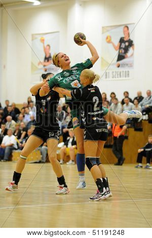SIOFOK, HUNGARY - SEPTEMBER 14: Katarina Bulatovic (with ball) in action at a Hungarian Championship handball match Siofok KC (black) vs. Gyori ETO KC (green), September 14, 2013 in Siofok, Hungary.