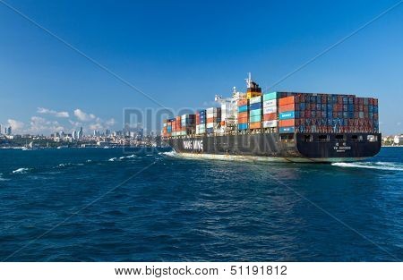 ISTANBUL, TURKEY - AUGUST 2: Container ship entering Bosphorus on August 2, 2013 in Istanbul, Turkey. 50,000 ships pass through the Straits every year.