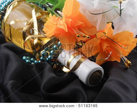 Bottle Of Champagne And Flowers. Festive Arrangement With Sparkling Wine And Flowers