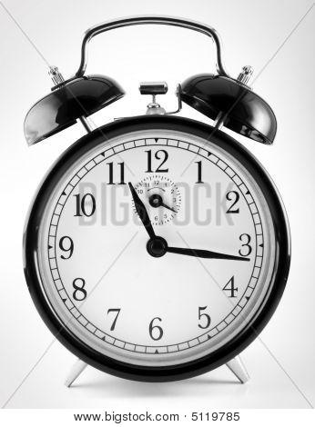 Black Alarm Clock On White Background
