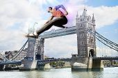 Male Athlete hurdling Tower Bridge