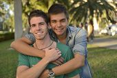 stock photo of homosexuality  - Portrait of a happy gay couple outdoors - JPG