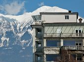 Hotel Building With Alps In Background poster