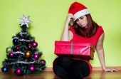 picture of sad christmas  - Sad young woman alone in Christmas time - JPG