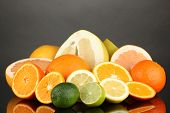 picture of pamelo  - Lots ripe citrus isolated on black - JPG
