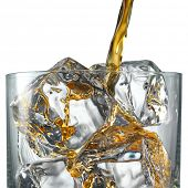 Pouring Scotch Whiskey in Glass with perfect ice isolated on white
