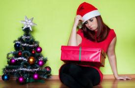pic of sad christmas  - Sad young woman alone in Christmas time - JPG