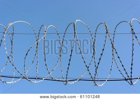 Barbwire On Sky Background