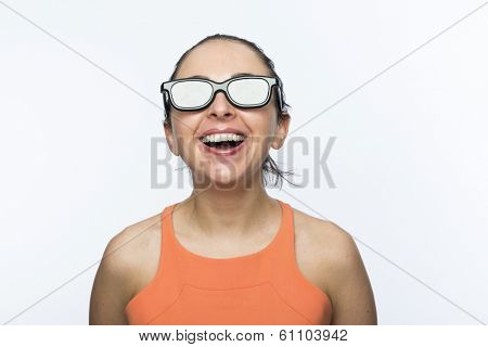 Portrait of beautiful caucasian woman wearing large 3D cinema glasses and smiling