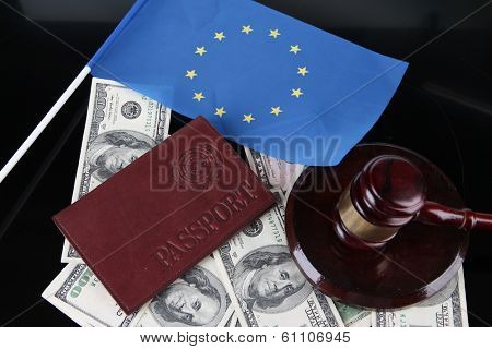 Gavel, money, passport and flag of Europe, on wooden background
