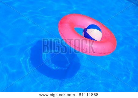Colorful Inflatable Ball And Round Tube Floating In Swimming Pool