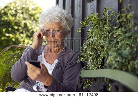 Senior Woman Looking At Mobile Phone