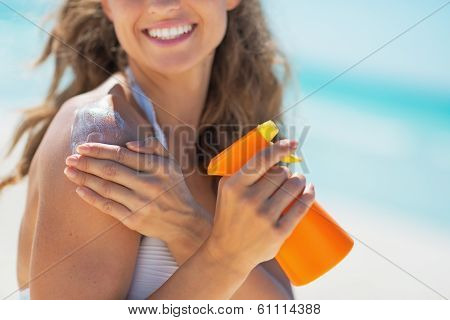 Closeup On Smiling Young Woman With Sun Screen